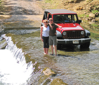 Bev & Carl with our rental crossing the Wailua River