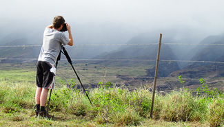 Carl photographing a distant canyon. Photo by Bev Amoth