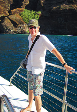 The world's largest hibiscus is on the cliff behind Carl. Photo by Bev Amoth