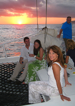 Bev and new friends enjoying the sea and sunset aboard a 65' catamaran, the Tropicat