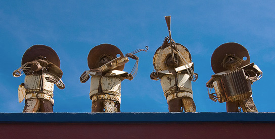 Large metal mariachi sculpture on the rooftop of the Hotel California. Todos Santos.