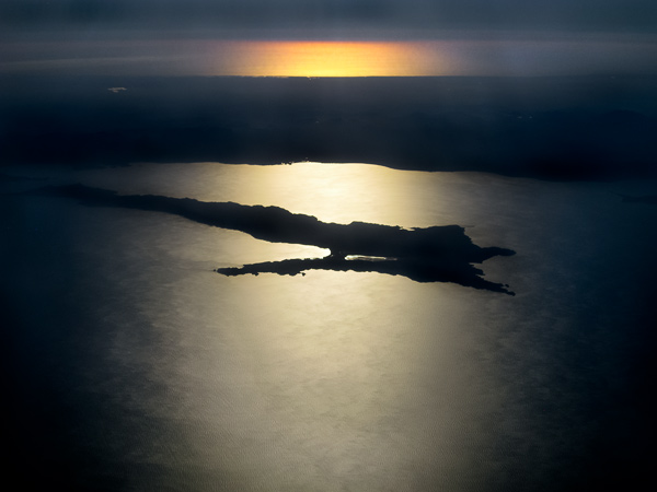 Parting Shot: Sun setting over the Sea of Cortez (foreground), Baja peninsula, and the Pacific (background) at 30,000 ft.