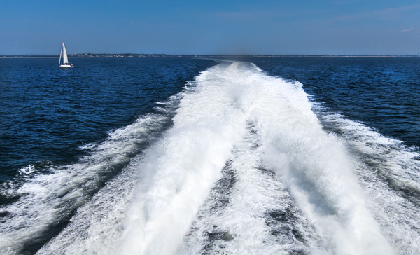 The high-speed ferry making waves with Cape Cod on the horizon.