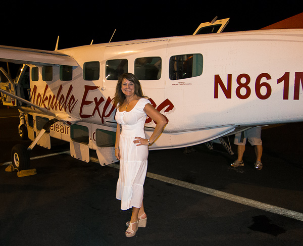 Bev next to our ride to Kona: Mokulele Airline's Cessna 208B Grand Caravan