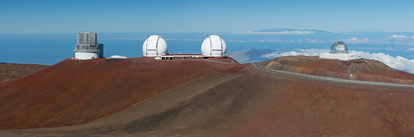Some of the observatories on the summit of Mauna Kea. Mt Haleakala, in Maui, is visible on the horizon (some 80 miles away). © Carl Amoth