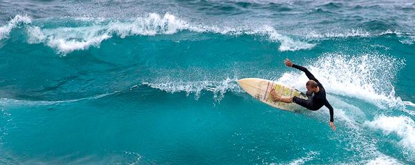 Surfer near Ho'okipa Beach, Maui. © Carl Amoth