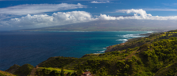 View of Haleakala Mountain on the horizon from the Kahekili Highway in Northwestern Maui. © Carl Amoth